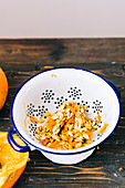 Pumpkin seeds in a colander