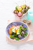 Hash browns with a spinach and radish medley and a poached egg