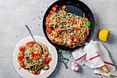 Whole-grain tomato pasta with basil pesto and bell pepper