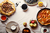 Traditional autumn pies arranged on white linen fabric
