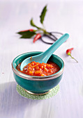 Chilli sauce with papaya in an oriental bowl