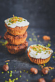 Carrot muffins with cream cheese, hazelnuts, honey and pistachio nuts