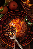 Christmas pudding with candied oranges