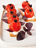 Quick tomato and goat's cheese tart with tapenade