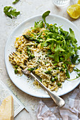 Risotto with peas, asparagus and rocket salad with parmesan