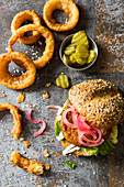 Veggie Vegan Burger made with cauliflower beans and pickled red onions and fried onion rings