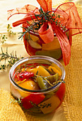 Pickled peppers with rosemary and thyme in jars as a gift
