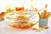 Pear punch with physalis served with savoury snacks