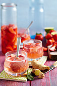 Non-alcoholic strawberry punch with ginger and lime