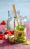 Non-alcoholic punch with strawberries, limes, mint and brown sugar being made
