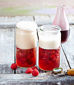 Wheat beer punch with raspberry syrup and raspberries
