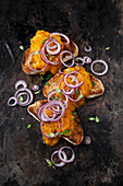 Yellow pepper spread on toast with red onions