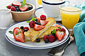 Baked french toast with cream cheese filling and fresh berries