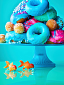 Colourful donuts on a cake stand