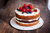 A Victoria sponge cake with summer berries