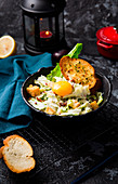 Mixed leaf salad with croutons, egg yolks and grilled bread