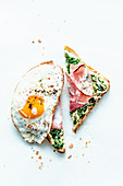 Toast with herbs, ham and a fried egg
