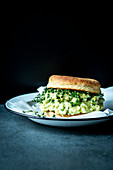 An English muffin with avocado-and-egg salad and cress