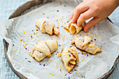 Apple croissants with herb sugar
