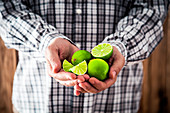 Farmers hands with fresh limes