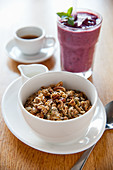 Breakfast muesli, a smoothie and coffee