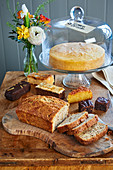 A walnut cake and a lemon drizzle cake on a cake buffet