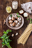 Ingredients for a pasta dish with mushroom sauce