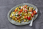 Yellow lentil salad with vegetables and feta cheese