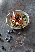 Fruity fresh quinoa porridge with figs and blueberries