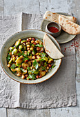 Vegan chickpea dish with Brussels sprouts and hazelnuts