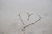 Heart symbol etched in sand