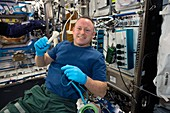ISS astronaut demonstrating 3D printing, 2014