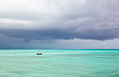 Fishing boat and approaching storm, Zanzibar