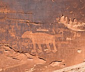Ancient petroglyph of a bear hunt