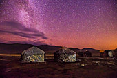 Stone and Thatch huts under Milky way, Sani Pass, Lesotho