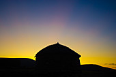 Silhouette of huts in front of the sunset, Lesotho