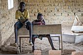 A girl and boy in classroom, Ganta, Liberia