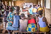Adults and children in a classroom, Ganta, Liberia