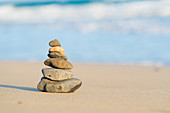Pyramid of stones on a sandy beach