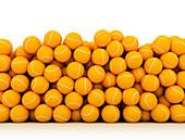 Stack of orange tennis balls, illustration