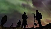 Star gazers watching aurora, timelapse