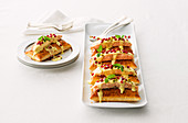 Sides of salmon on puff pastry with white wine sabayon and pomegranate seeds