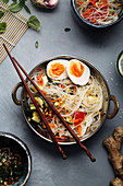 Spicy veggie wok with noodles and eggs