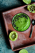 Avocado smoothie with apple juice, lime juice and spinach