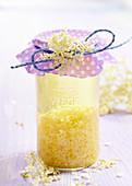 Homemade elderflower vinegar in a jar with a bow