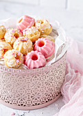 Mini lemon and yoghurt Bundt cakes with pink and white icing