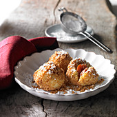 Damson dumplings roasted in butter with breadcrumbs and icing sugar