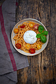 Spaghetti with pesto rosso, cherry tomatoes and burrata
