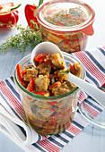 Pork ragout with pepper in a jar