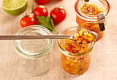 Tomato salsa with cumin in jars